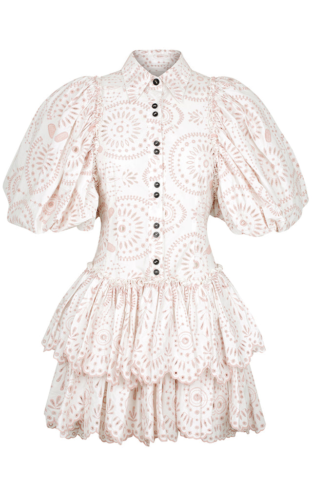 The Alice Mini Dress is a button up style with exaggerated balloon sleeves and tiered skirting panels. Featuring unique in house designed broderie anglaise patterning.