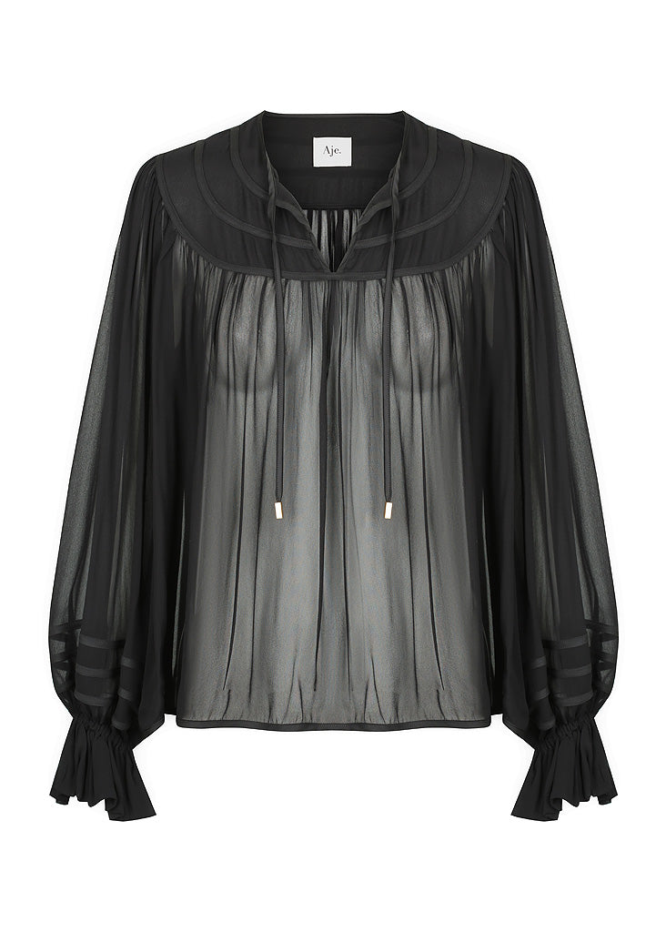 The Banka Blouse is a relaxed fitting, semi sheer style with tie up neckline and exaggerated sleeves.