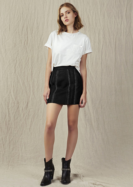 The Aje Nevado Mini is a black high-waisted skirt made from 100% genuine leather with intricate detailed paneling.
