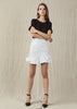 The Aje Natalia Mini is a high waisted skirt with ruffles and button embellishments.