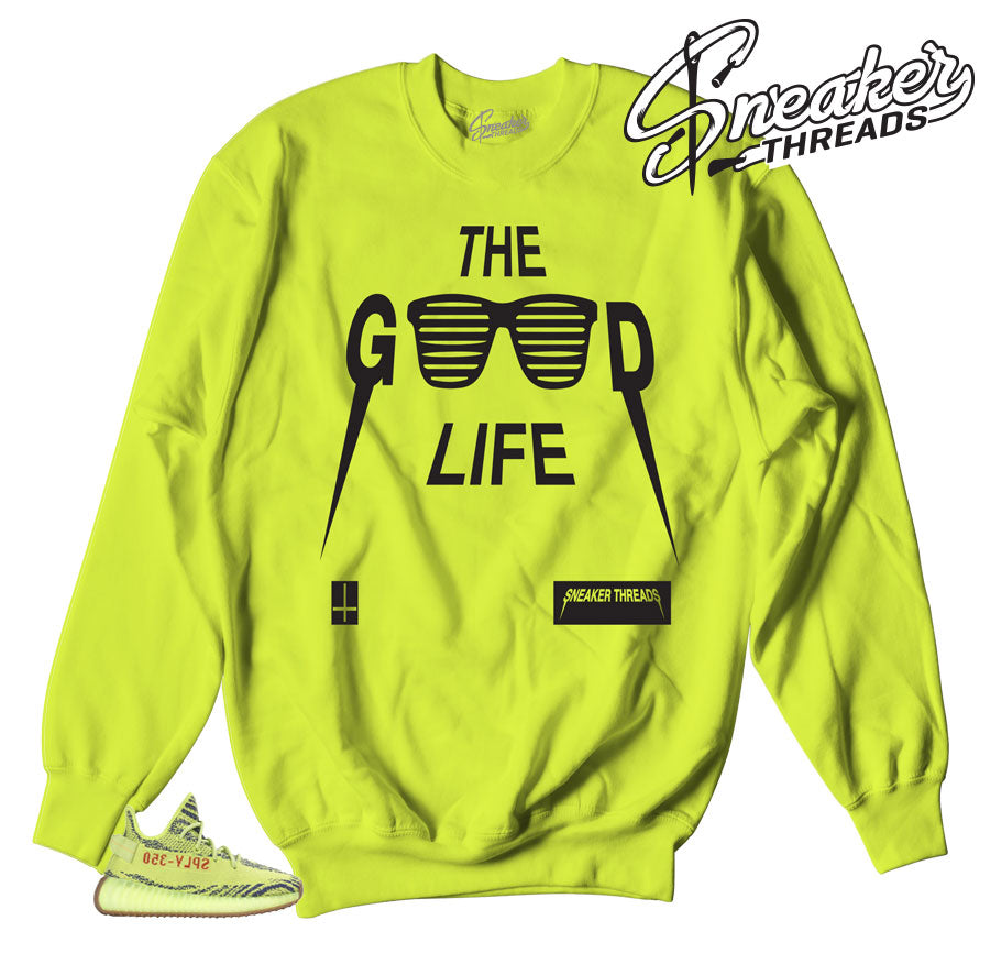 Frozen yellow yeezy sweaters collection of shirts to match shoes.