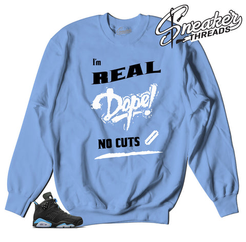 Sweaters match Jordan 6 UNC university blue sneakers.