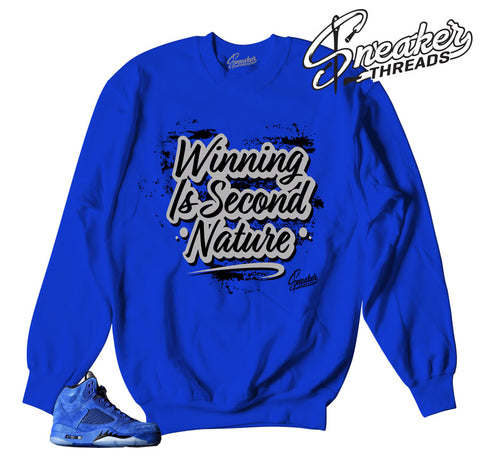 Number one sweaters match Jordan 5 blue suede sneakers