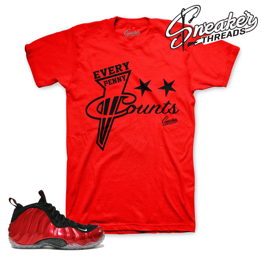 Foamposite metallic red tee match varsity foam shoes.