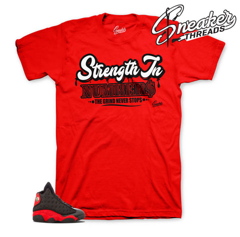 Shirts match Jordan 13 bred | strength in numbers tee