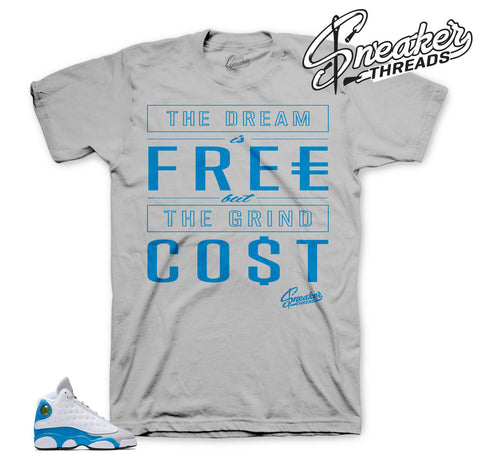 Tees match Jordan 13 blue italy shoes. Official sneaker tees.