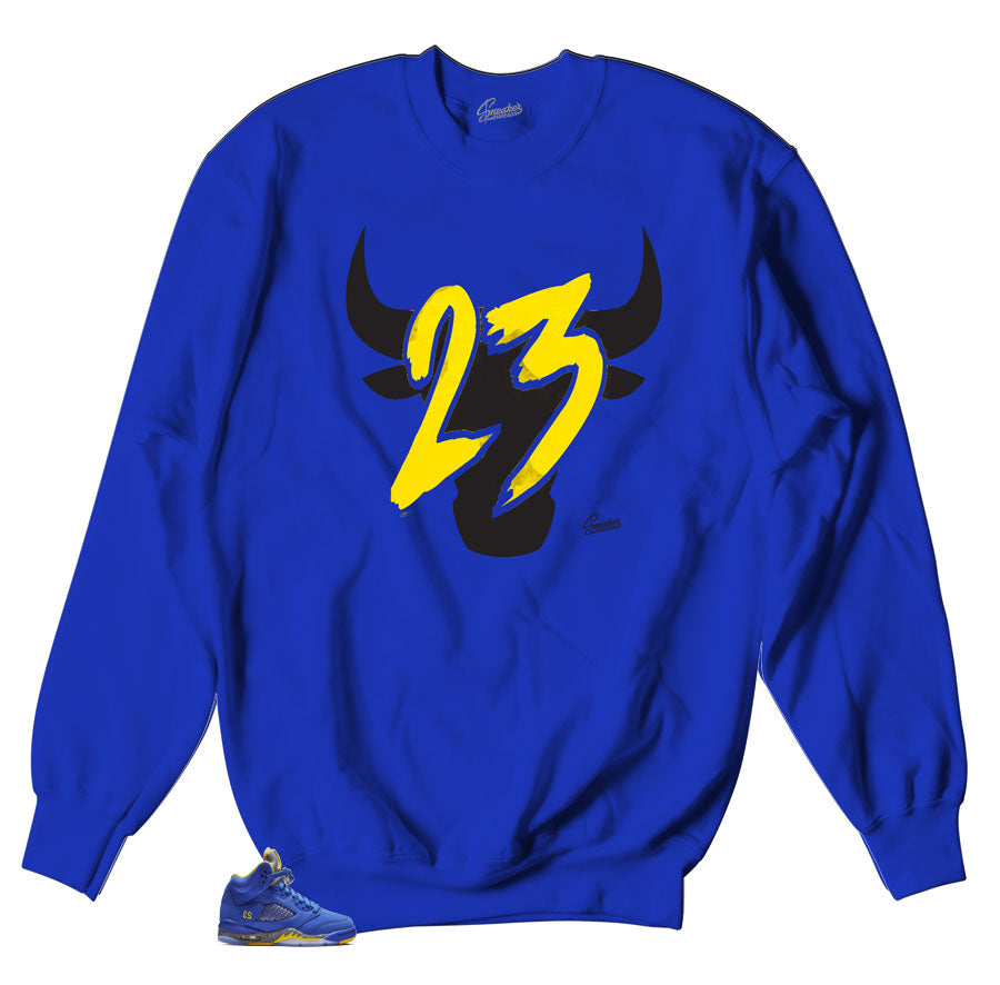 Jordan 5 Laney sneaker matches sweater designed to match retro Jordan 5