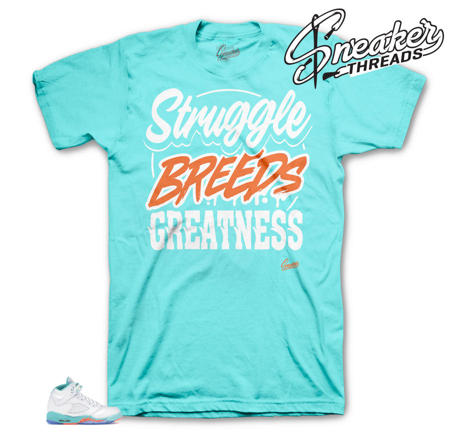 Struggle Breeds Light Aqua 5's shirt