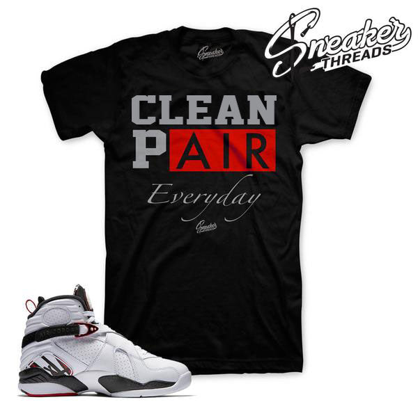 Shirts match Jordan 8 shoes.