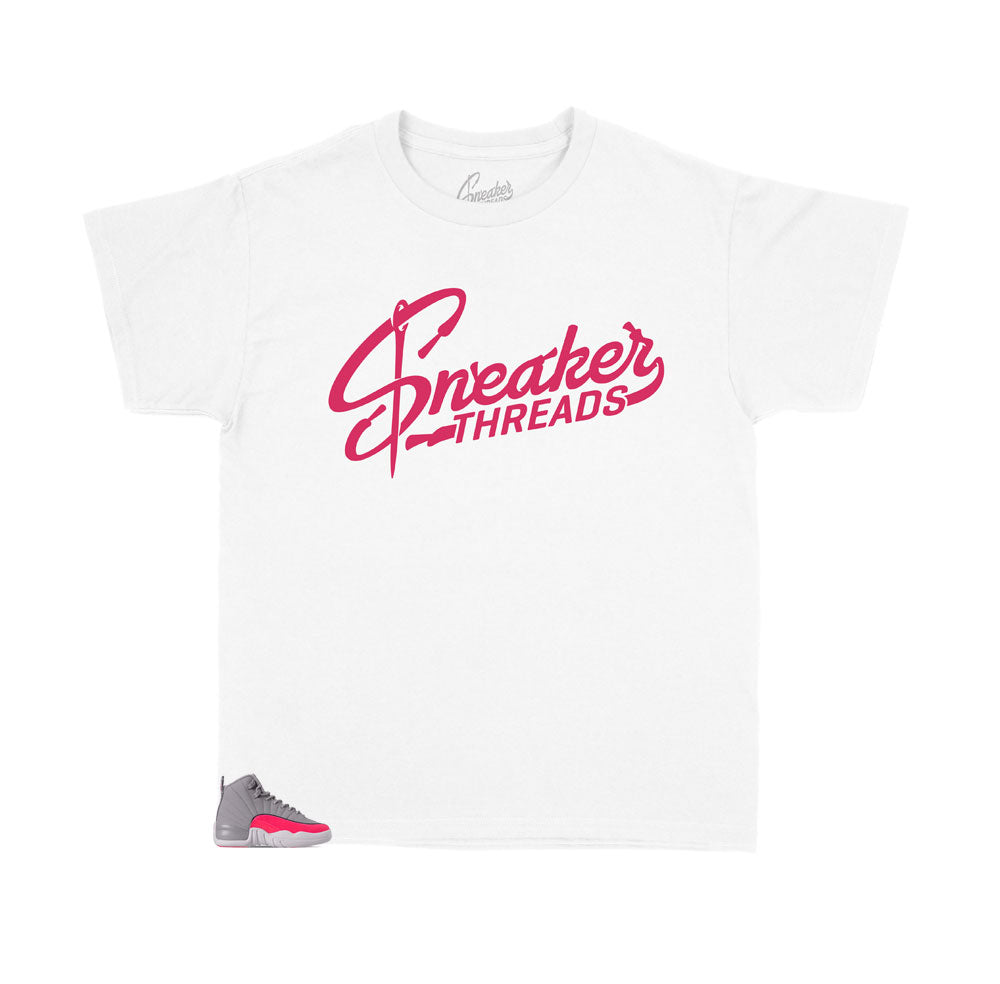 Jordan 12 kids racer pink sneakers have kids shirts designed to match with the Jordan 12 racer pink sneakers