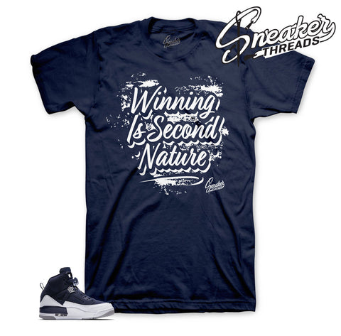 Jordan spizike navy tees and clothing match shoes.