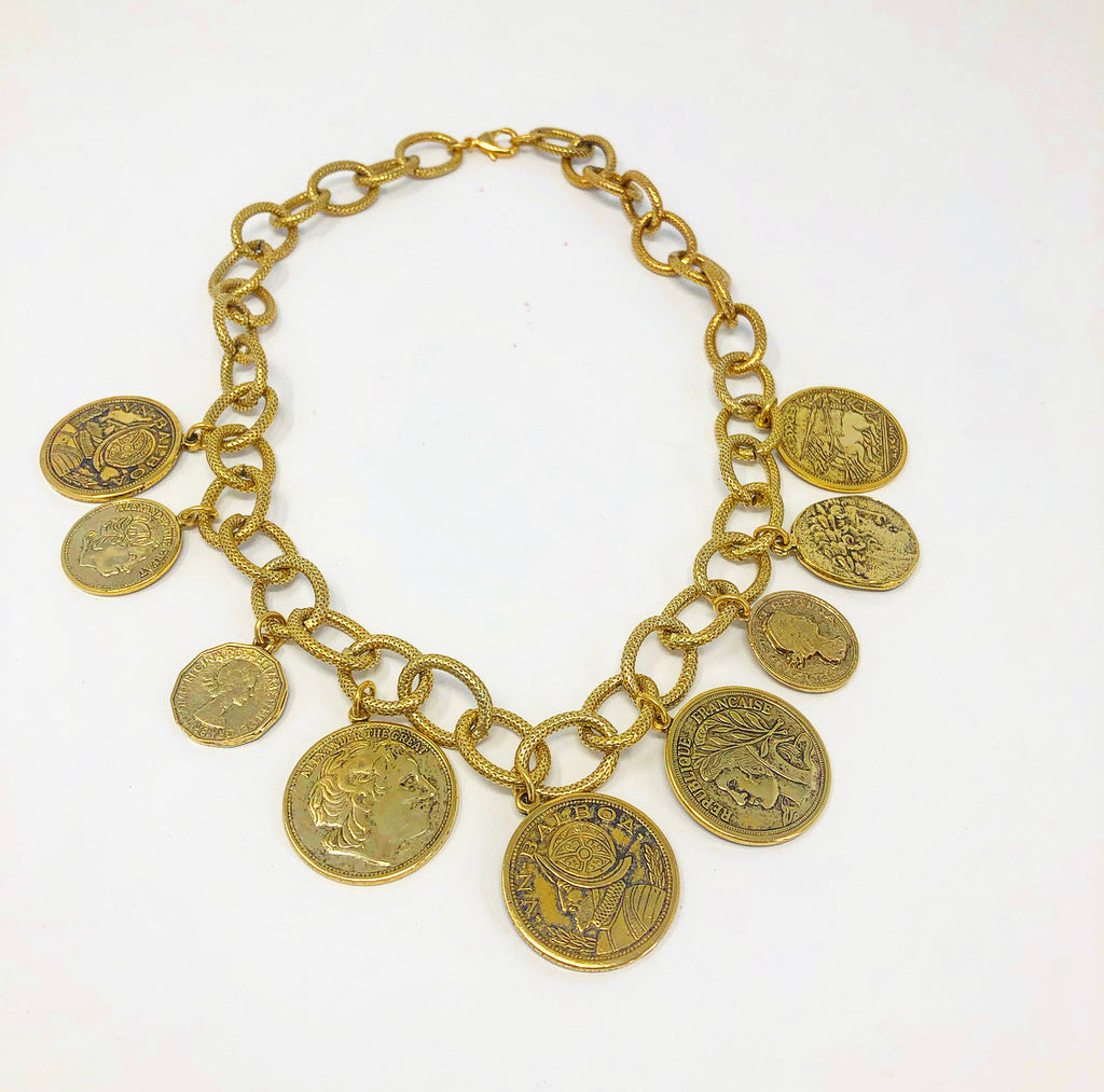 Gold tone link metal necklace with gold tone metal coins