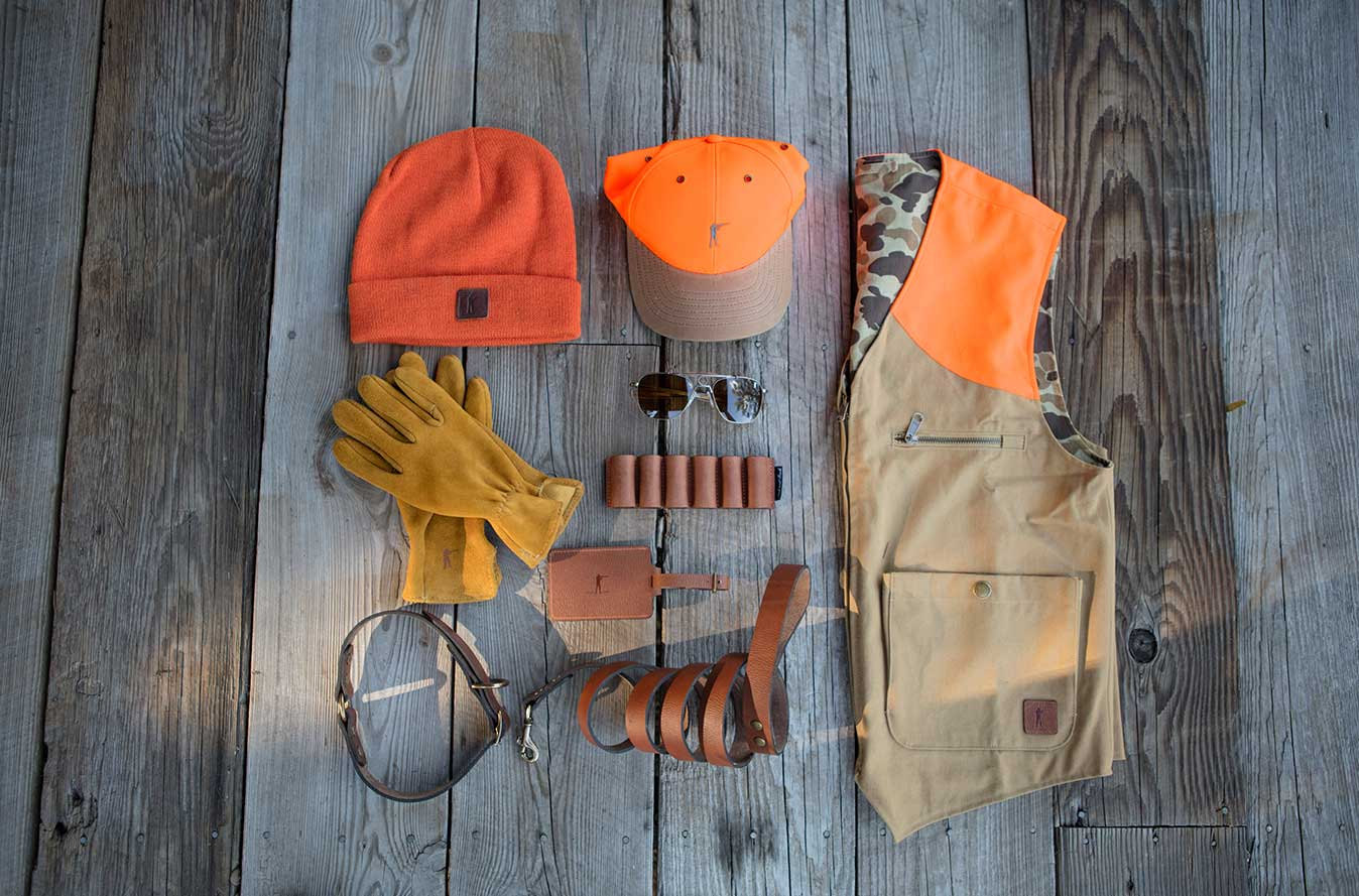 Dog Collar | Dog Leash | Deer Skin Leather Gloves Unlined, Saddle | The Upland Hat | Shell Holder Patch, 12G | The Upland Vest, Field Blaze/Sig. Camo Reversible | Luggage Tag