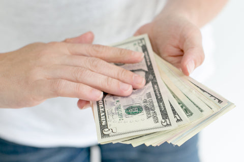 Man holding stack of cash.