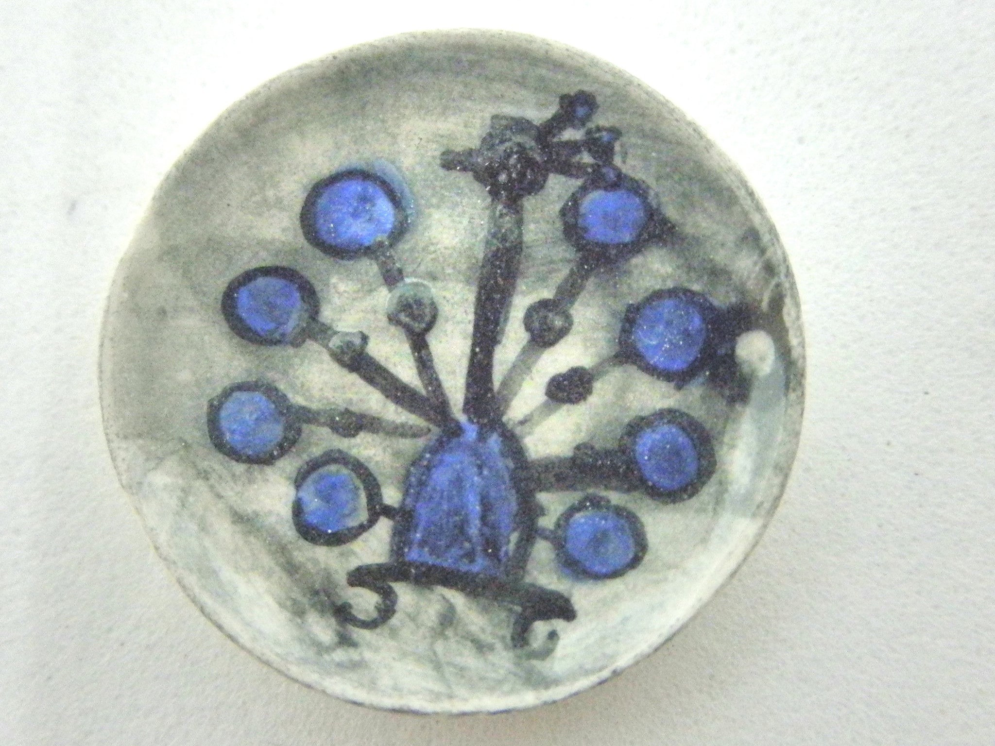Miniature ceramic plate - stylized peacock