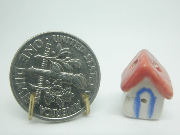 Miniature ceramic bird house with red roof