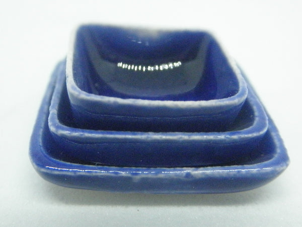 Miniature ceramic set of nestled square plates royal blue