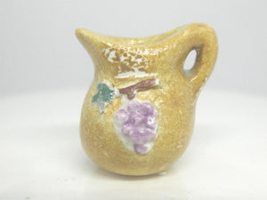 Miniature Italian pitcher with grapes