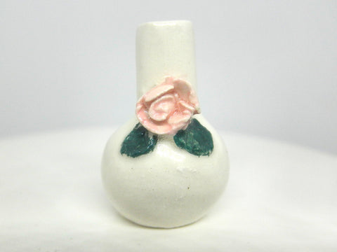 Miniature ceramic vase with pink rose
