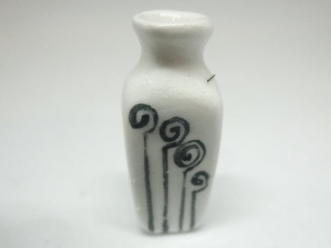 Miniature modern ceramic vase with stylized fern fronds.