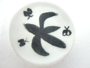 Miniature ceramic plate black and white with butterflies
