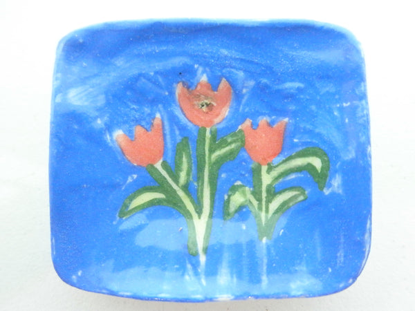 Miniature Majolica ceramic plate with tulips on blue