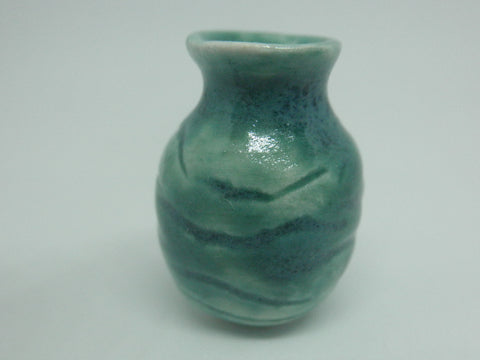 Miniature ceramic vase carved green