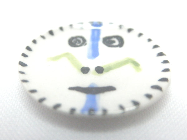 Miniature Picasso inspired small ceramic plate - face with blue stripe