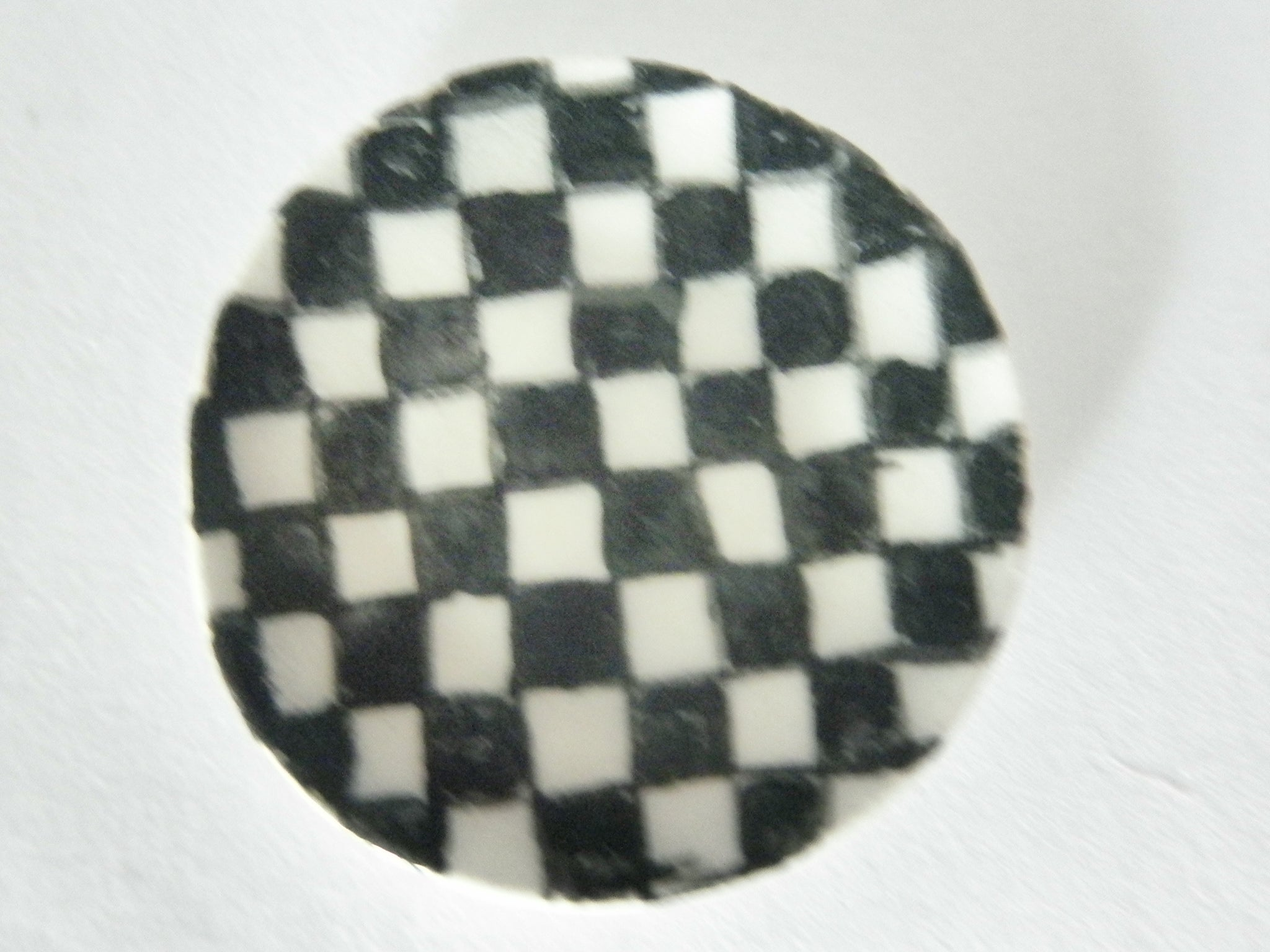 Miniature ceramic plate with checkered pattern
