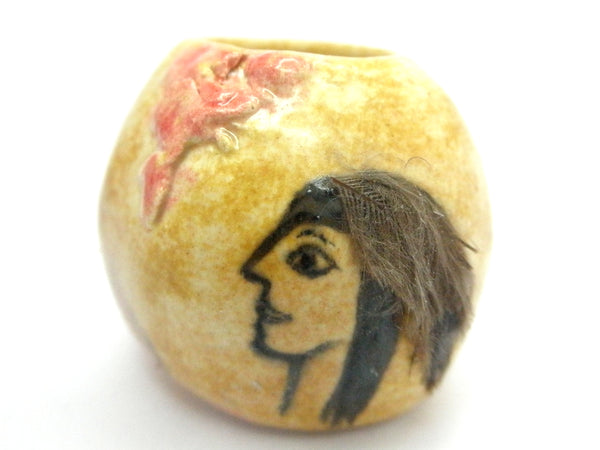 "Miniature ceramic round vase with ""brave"" profile and feather"