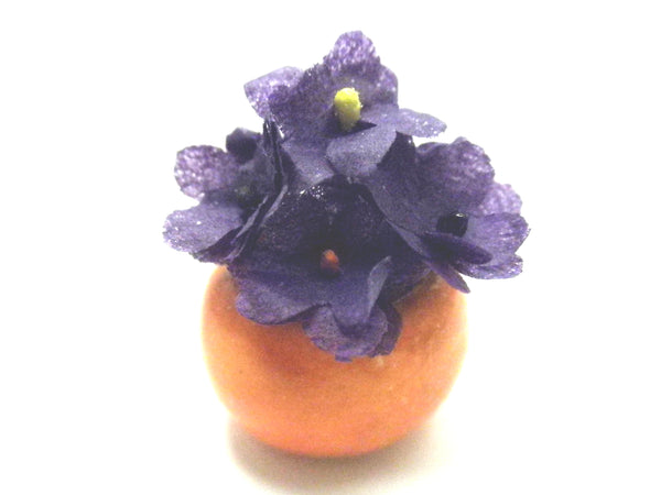 Miniature Ceramic Halloween orange vase with purple flowers