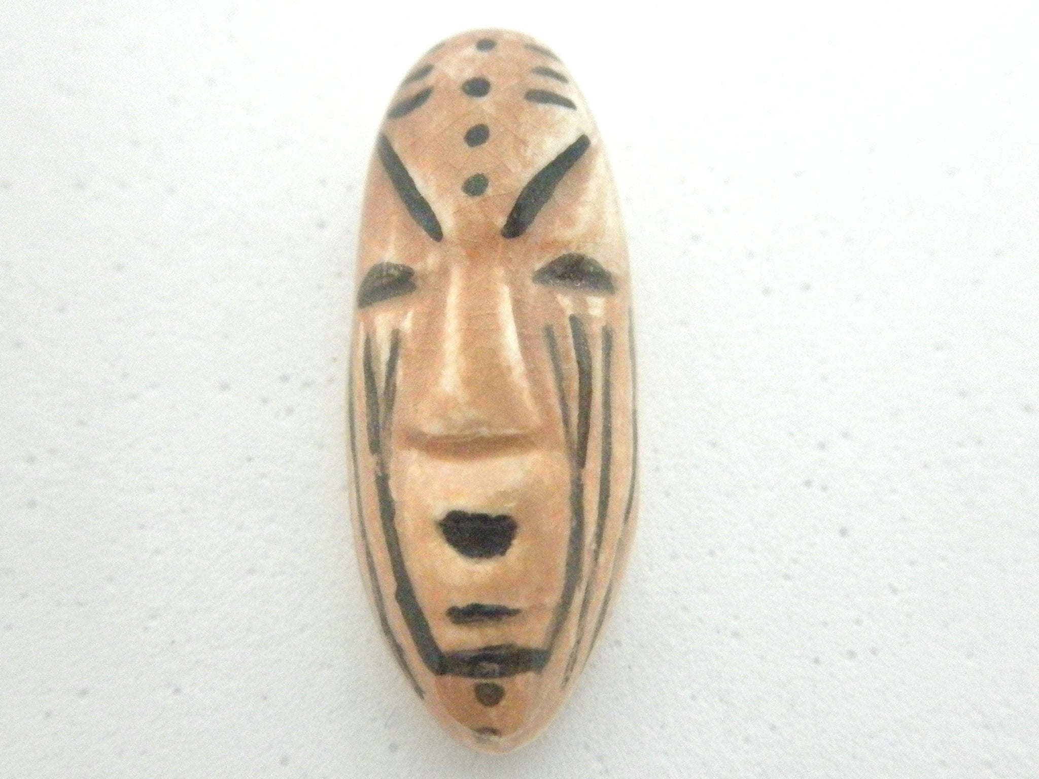 Miniature African art elongated beige and black