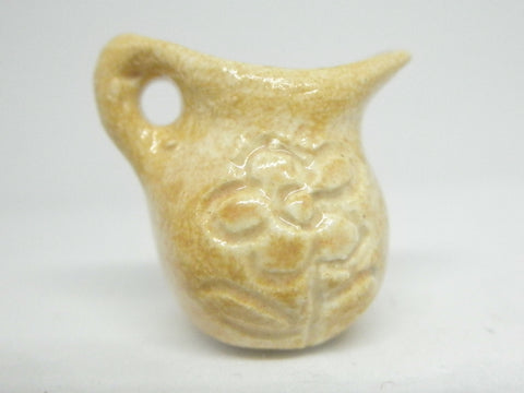 Miniature pitcher carved, sand beige