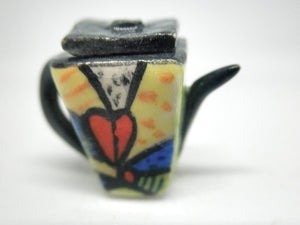 Miniature colorful teapot