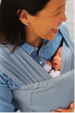 close parent Caboo baby carrier sling
