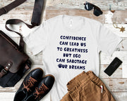 Confidence Can Lead Us To Greatness Short-Sleeve Unisex T-Shirt White,S,White,M,White,L,White,XL,White,2XL,White,3XL,Athletic Heather,S,Athletic Heather,M,Athletic Heather,L,Athletic Heather,XL,Athletic Heather,2XL,Athletic Heather,3XL,Soft Cream,S,Soft Cream,M,Soft Cream,L,Soft Cream,XL,Soft Cream,2XL,Soft Cream,3XL,Ash,S,Ash,M,Ash,L,Ash,XL,Ash,2XL,Heather Prism Mint,S,Heather Prism Mint,M,Heather Prism Mint,L,Heather Prism Mint,XL,Heather Prism Mint,2XL,Heather Prism Mint,3XL,Heather Blue,S,Heather Blue,M