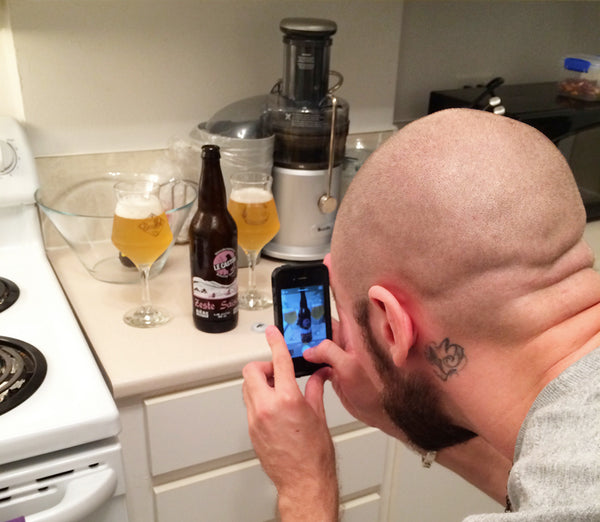 Montreal rapper Cee photographing his craft beer