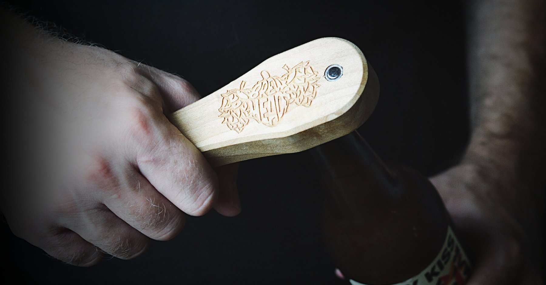 Wooden bottle opener doesn't bend your bottle caps