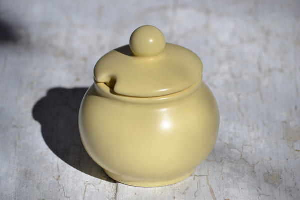 matte yellow covered pot