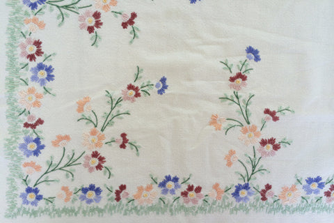 linen tablecloth with embroidered wildflowers