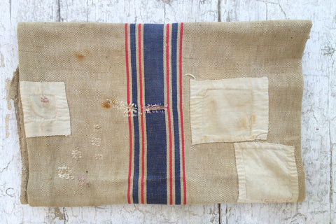 mended striped grain sack