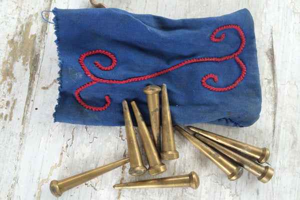 bag of brass pegs