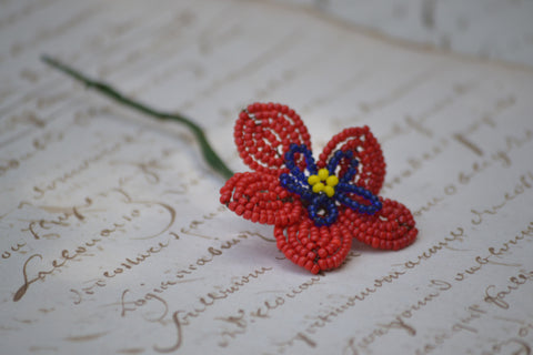 red-blue-yellow beaded flower