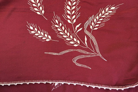 red topper with embroidered wheat stalks
