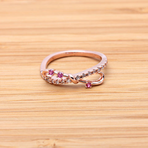wide INFINITY ring with rubys, in pinkgold - girlsluv.it