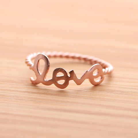 LOVE ring with twisted band, in pinkgold - girlsluv.it