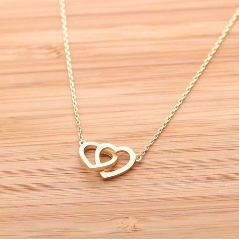 CROSSED OPEN HEART, never apart necklace in gold(plated, 925 sterling) - girlsluv.it  - 1