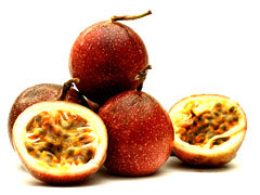 Passion Fruit, whole and cut in half, for our Passionfruit black tea.