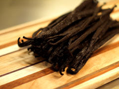 Whole vanilla pods on a cutting board, for our vanilla-flavored black tea.