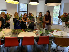 people arranging bouquets